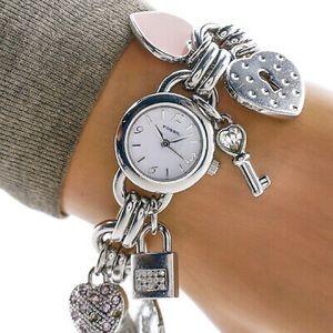 Fossil dress charm bracelet watch